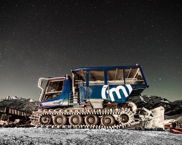 Trasporto con il gatto delle nevi cabinato alla cena in quota del Camanel di Planon sulla ski area Mottolino a Livigno